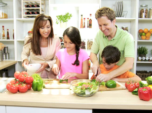 Family in kitchen - Questions to ask before choosing a Contractor - Fort Myers - Richardson Custom Homes