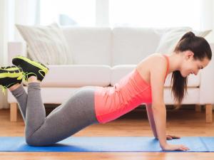 woman exercising on floor