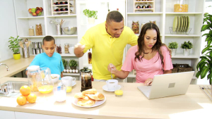 Family in kitchen – 5 Clues why the Kitchen is the heart of your home - Fort Myers - Richardson Custom Homes